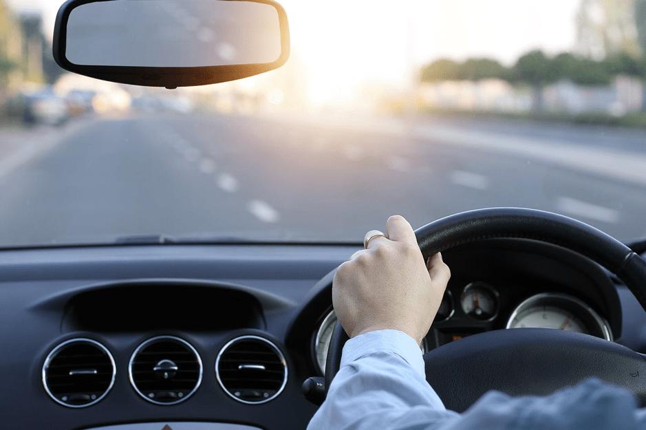 Deans' autoglass - man driving - beat the heat during summer
